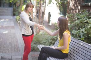 Ladies shaking hands